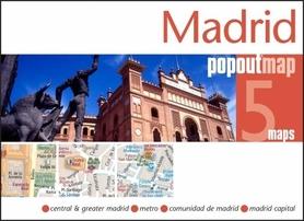 Zdjęcie przedstawia pomnik oraz zabudowania w centrum Madrytu.